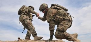 Military man helping another military man