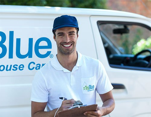 TruBlue Franchise Handyman in Front of His Truck