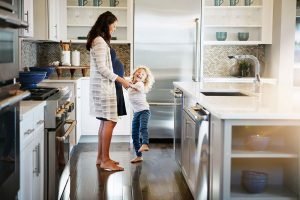 Mom and daughter dancing in kitchen