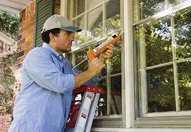 Handyman fixing a window