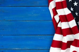 American flag on rustic blue wood background