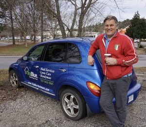 Tim Diemont, TruBlue Franchise Owner standing next to his TruBlue car